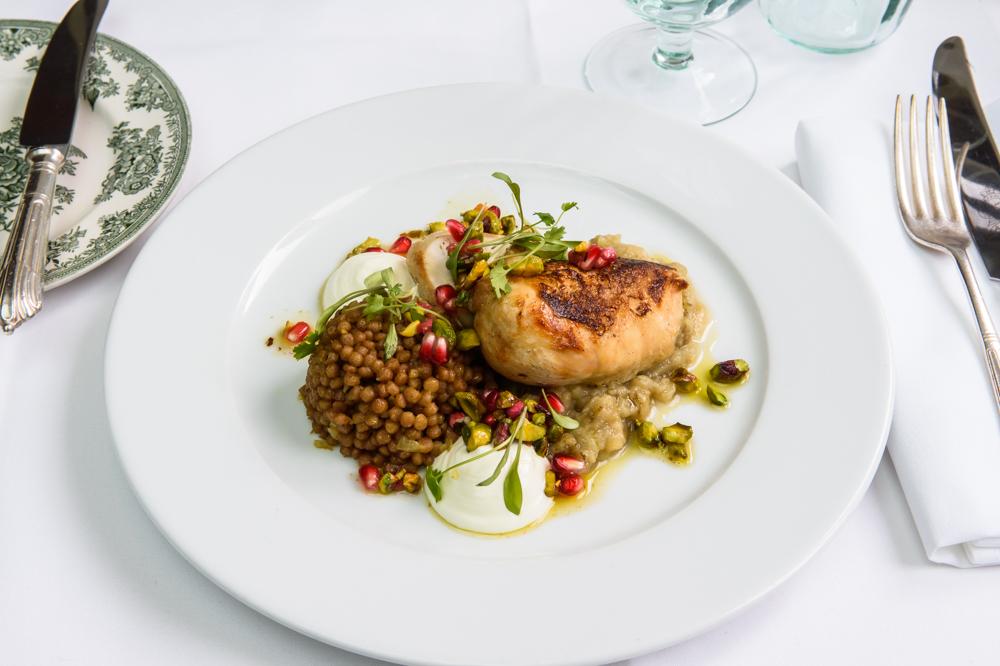 Roast Chicken breast, raz el hanout couscous, aubergine caviar, smoked yoghurt, pistachio and pomegranate dressing, American Bar Restaurant, London Coliseum © Karen Hatch