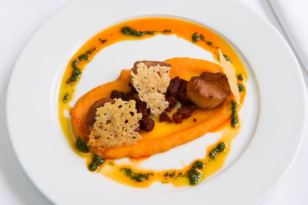 Seared scallops, butternut squash purée and chorizo, parmesan and rocket oil